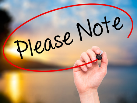 inconvenience: Man Hand writing Please Note with black marker on visual screen. Isolated on nature. Business, technology, internet concept. Stock Photo