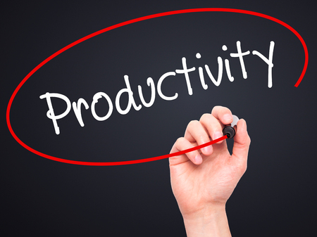 yielding: Man Hand writing  Productivity with black marker on visual screen. Isolated on black. Business, technology, internet concept. Stock Photo