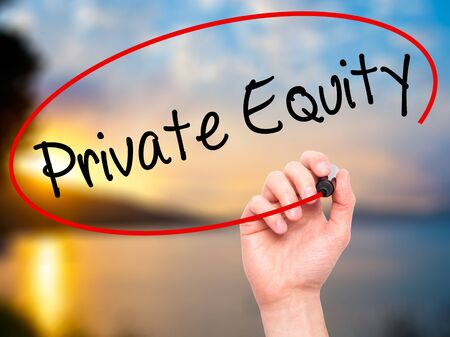 equity: Man Hand writing Private Equity with black marker on visual screen. Isolated on nature. Business, technology, internet concept. Stock Photo