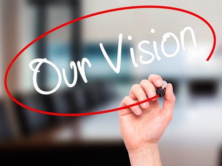 our vision: Man Hand writing Our Vision with black marker on visual screen. Isolated on office. Business, technology, internet concept. Stock Photo Stock Photo