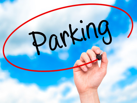 multi storey: Man Hand writing Parking with black marker on visual screen. Isolated on sky. Business, technology, internet concept. Stock Photo Stock Photo