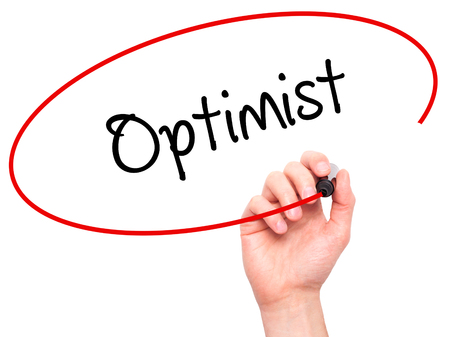 and an optimist: Man Hand writing Optimist  with black marker on visual screen. Isolated on white. Business, technology, internet concept. Stock Photo