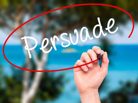persuade: Man Hand writing Persuade with black marker on visual screen. Isolated on background. Business, technology, internet concept. Stock Photo