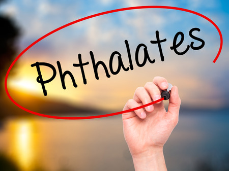 phthalates: Man Hand writing  Phthalates  with black marker on visual screen. Isolated on background. Business, technology, internet concept. Stock Photo Stock Photo