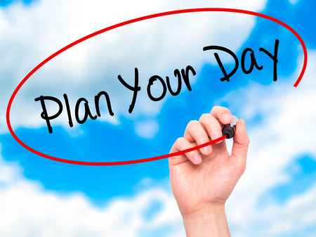 Man Hand writing Plan Your Day with black marker on visual screen. Isolated on background. Business, technology, internet concept. Stock Photo Stock Photo