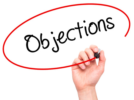 objections: Man Hand writing Objections  with black marker on visual screen. Isolated on white. Business, technology, internet concept. Stock Photo Stock Photo
