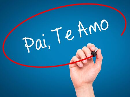paternal: Man Hand writing Pai, Te Amo (In portuguese - Love You, Dad) with black marker on visual screen. Isolated on blue. Business, technology, internet concept. Stock Photo
