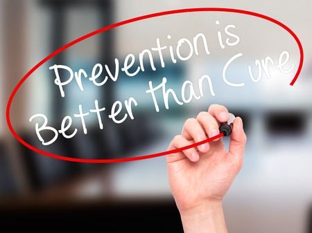 cure prevention: Man Hand writing Prevention is Better than Cure with black marker on visual screen. Isolated on office. Business, technology, internet concept. Stock Image