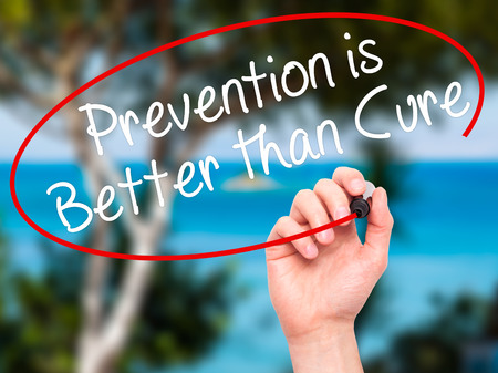 nature cure: Man Hand writing Prevention is Better than Cure with black marker on visual screen. Isolated on nature. Business, technology, internet concept. Stock Image
