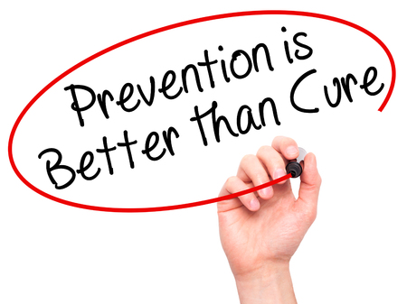 cure prevention: Man Hand writing Prevention is Better than Cure with black marker on visual screen. Isolated on white. Business, technology, internet concept. Stock Image