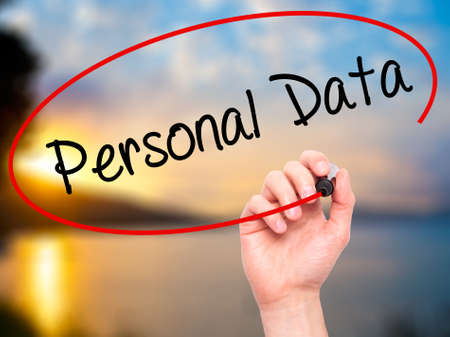 data protection act: Man Hand writing Personal Data  with black marker on visual screen. Isolated on background. Business, technology, internet concept. Stock Photo