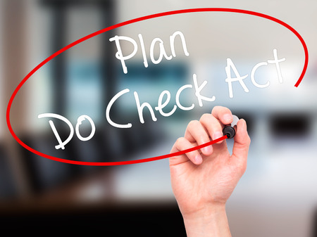plan do check act: Man Hand writing Plan Do Check Act  with black marker on visual screen. Isolated on office. Business, technology, internet concept. Stock Photo