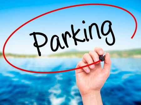 multi story: Man Hand writing Parking with black marker on visual screen. Isolated on nature. Business, technology, internet concept. Stock Photo