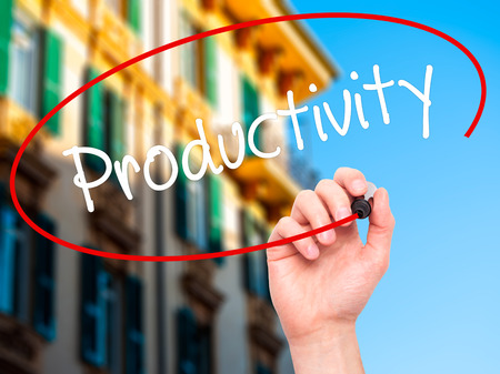 yielding: Man Hand writing  Productivity with black marker on visual screen. Isolated on city. Business, technology, internet concept. Stock Photo
