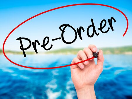 preorder: Man Hand writing Pre-Order  with black marker on visual screen. Isolated on background. Business, technology, internet concept. Stock Photo Stock Photo
