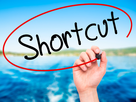 shortcut: Man Hand writing Shortcut with black marker on visual screen. Isolated on nature. Business, technology, internet concept. Stock Photo Stock Photo