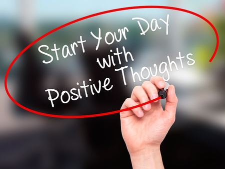 dat: Man Hand writing Start your Dat with Positive Thoughts with black marker on visual screen. Isolated on office. Business, technology, internet concept. Stock Photo