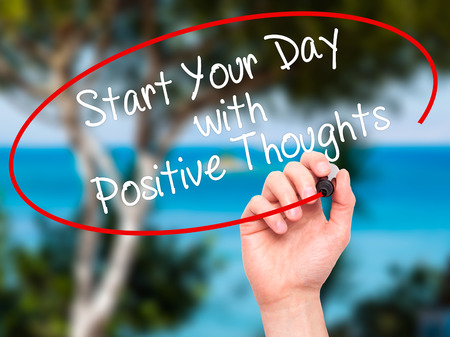 dat: Man Hand writing Start your Dat with Positive Thoughts with black marker on visual screen. Isolated on nature. Business, technology, internet concept. Stock Photo