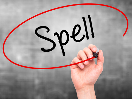 grammatical: Man Hand writing Spell with black marker on visual screen. Isolated on grey. Business, technology, internet concept. Stock Photo