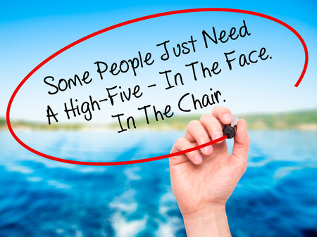 naivety: Man Hand writing Some People Just Need A High-Five - In The Face. In The Chair  with black marker on visual screen. Isolated on nature. Business, technology, internet concept. Stock Photo