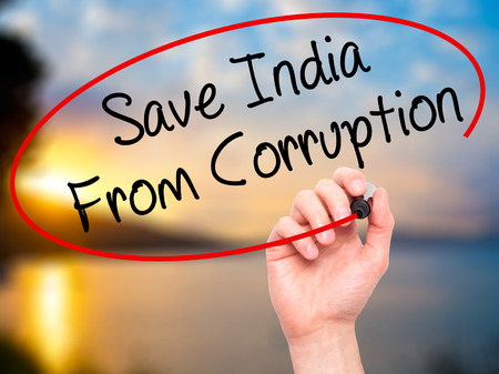 demonstrators: Man Hand writing Save India From Corruption with black marker on visual screen. Isolated on background. Business, technology, internet concept. Stock Photo