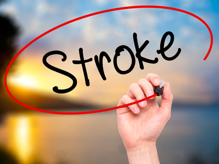 brain damage: Man Hand writing Stroke with black marker on visual screen. Isolated on background. Business, technology, internet concept. Stock Photo Stock Photo
