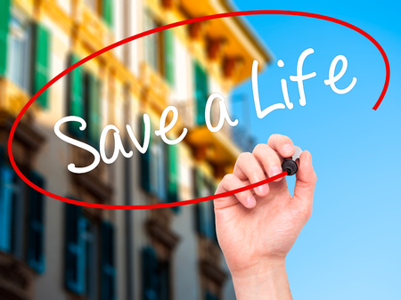 drunk test: Man Hand writing Save a Life  with black marker on visual screen. Isolated on city. Business, technology, internet concept. Stock Photo