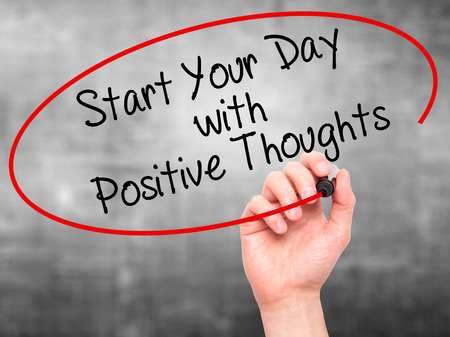 Man Hand writing Start your Dat with Positive Thoughts with black marker on visual screen. Isolated on grey. Business, technology, internet concept. Stock Photo Фото со стока