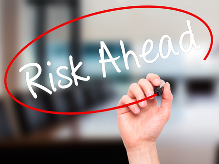 avoidance: Man Hand writing Risk Ahead with black marker on visual screen. Isolated on office. Business, technology, internet concept. Stock Image