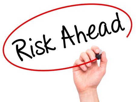 risk ahead: Man Hand writing Risk Ahead with black marker on visual screen. Isolated on white. Business, technology, internet concept. Stock Image