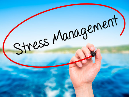 pressured: Man Hand writing Stress Management with black marker on visual screen. Isolated on nature. Business, technology, internet concept. Stock Photo