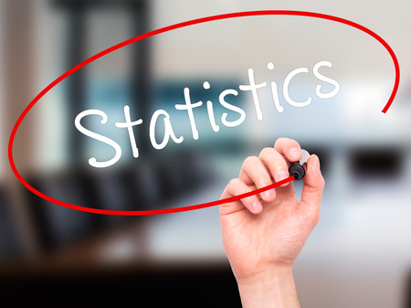 regression: Man Hand writing Statistics with black marker on visual screen. Isolated on office. Business, technology, internet concept. Stock Photo