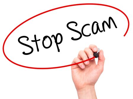 scamming: Man Hand writing Stop Scam with black marker on visual screen. Isolated on background. Business, technology, internet concept. Stock Photo