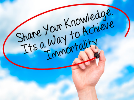 immortality: Man Hand writing Share Your Knowledge. Its a Way to Achieve Immortality with black marker on visual screen. Isolated on sky. Business, technology, internet concept. Stock Photo