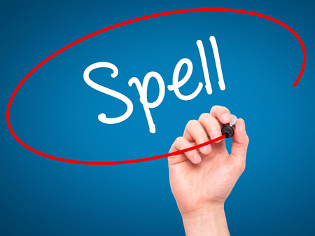 grammatical: Man Hand writing Spell with black marker on visual screen. Isolated on blue. Business, technology, internet concept. Stock Photo Stock Photo