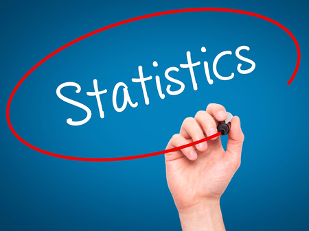 regression: Man Hand writing Statistics with black marker on visual screen. Isolated on blue. Business, technology, internet concept. Stock Photo