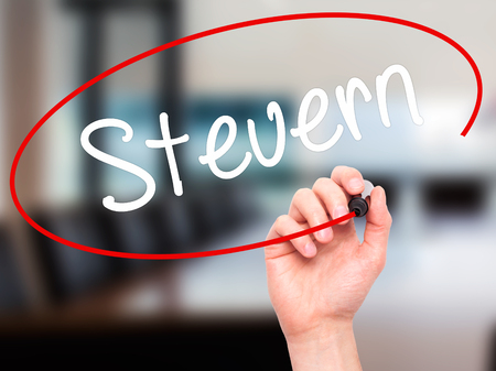 taxpayer: Man Hand writing Steuern (German Tax) with black marker on visual screen. Isolated on background. Business,  technology, internet concept. Stock Photo