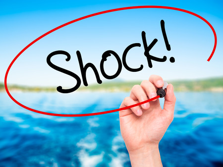 gosh: Man Hand writing Shock! with black marker on visual screen. Isolated on background. Business, technology, internet concept. Stock Photo Stock Photo