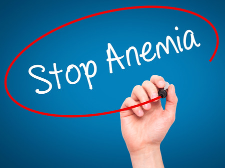 anemia: Man Hand writing Stop Anemia with black marker on visual screen. Isolated on background. Business, technology, internet concept. Stock Photo Stock Photo