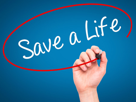 t bar: Man Hand writing Save a Life  with black marker on visual screen. Isolated on blue. Business, technology, internet concept. Stock Photo