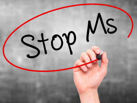 spasms: Man Hand writing Stop Ms with black marker on visual screen. Isolated on grey. Business, technology, internet concept. Stock Photo