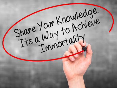 immortality: Man Hand writing Share Your Knowledge. Its a Way to Achieve Immortality with black marker on visual screen. Isolated on grey. Business, technology, internet concept. Stock Photo Stock Photo