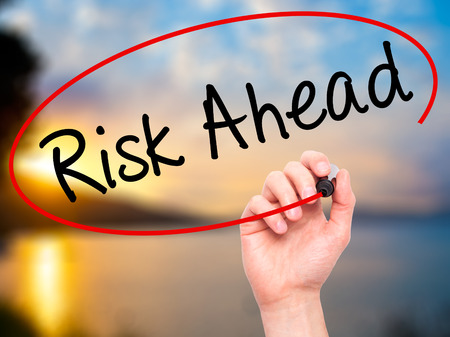 risk ahead: Man Hand writing Risk Ahead with black marker on visual screen. Isolated on nature. Business, technology, internet concept. Stock Image Stock Photo