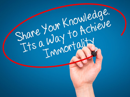 immortality: Man Hand writing Share Your Knowledge. Its a Way to Achieve Immortality with black marker on visual screen. Isolated on blue. Business, technology, internet concept. Stock Photo Stock Photo