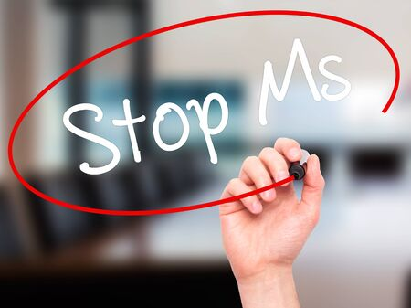 spasms: Man Hand writing Stop Ms with black marker on visual screen. Isolated on office. Business, technology, internet concept. Stock Photo Stock Photo