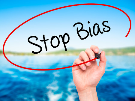 biased: Man Hand writing Stop Bias with black marker on visual screen. Isolated on nature. Business, technology, internet concept.