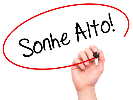 Man Hand writing Sonhe Alto! (Dream Big in Portuguese) with black marker on visual screen. Isolated on white. Business, technology, internet concept. Stock Photo Imagens