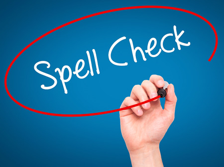 grammatical: Man Hand writing Spell Check  with black marker on visual screen. Isolated on blue. Business, technology, internet concept.