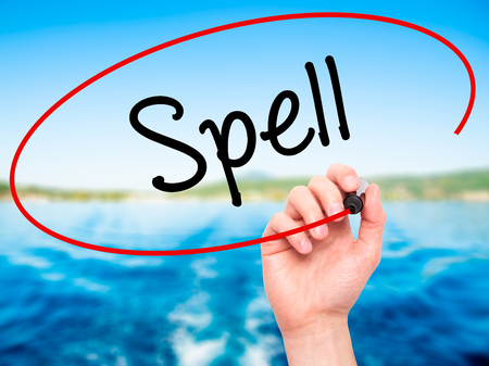 grammatical: Man Hand writing Spell with black marker on visual screen. Isolated on nature. Business, technology, internet concept. Stock Photo