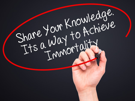 immortality: Man Hand writing Share Your Knowledge. Its a Way to Achieve Immortality with black marker on visual screen. Isolated on black. Business, technology, internet concept. Stock Photo